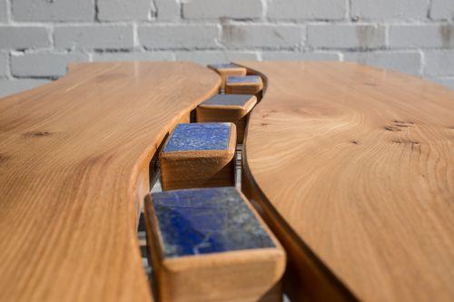 Wave table  Wave table in Scottish elm on oak legs with elm stretchers. Centre pieces are lapiz lazuli tiles.  Dimensions: Length: 125cm Width: 70cm Height: 60cm  Materials: Oak / Elm / Stone / Acrylic