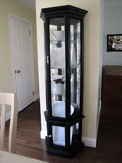 I have this curio cabinet and am definitely painting it black after seeing this blog!