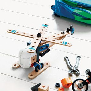 Brio builder helicopter kit on a bedroom floor