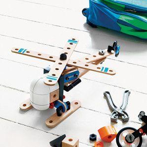 Brio builder helicopter kit on a bedroom floor