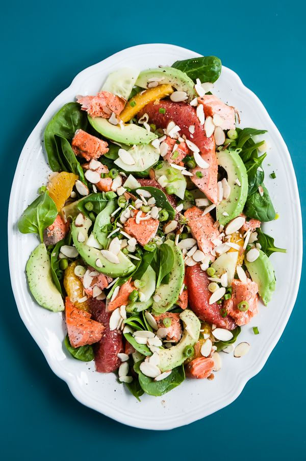 A heart healthy main dish salmon salad loaded up with avocado, citrus, and almonds. Gluten-free.