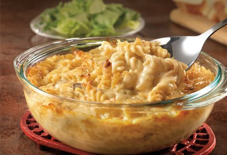 """This mouthwatering version of baked macaroni and cheese is ready injust 40minutes and features our """"secret ingredient"""" - cream of mushroom soup. Try it as a side dish too! (Add chicken and bacon bits to the top)"""