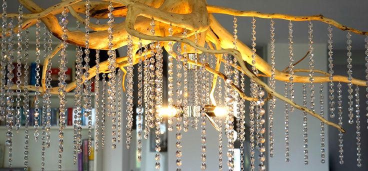 With its atmospheric, pleasant light, the root-chandelier enchants its surrounding into an elegant ambience. We love to integrate a customers wishes and imaginations to design and create beautiful and unique pieces. #interior #lighting #design #luxury #living #home #unique #root #lamps #crystal #chandelier #wooden #natural