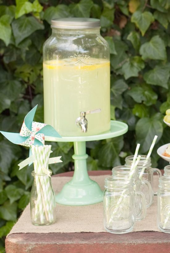 Use a cake stand to boost a beverage dispenser. | Events design: Real Parties. I like this look. Might be something to make ours different. I was also thinking hat boxes could be cool.