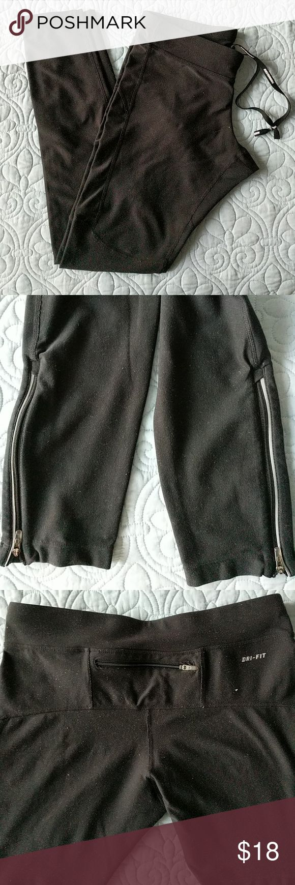Nike Running Dri-Fit Pants Full length, very durable running pants. Only one small wear spot under Nike logo (see pic). Otherwise, great condition. Nike Pants Leggings