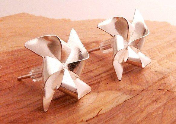 silver pinwheel earrings.