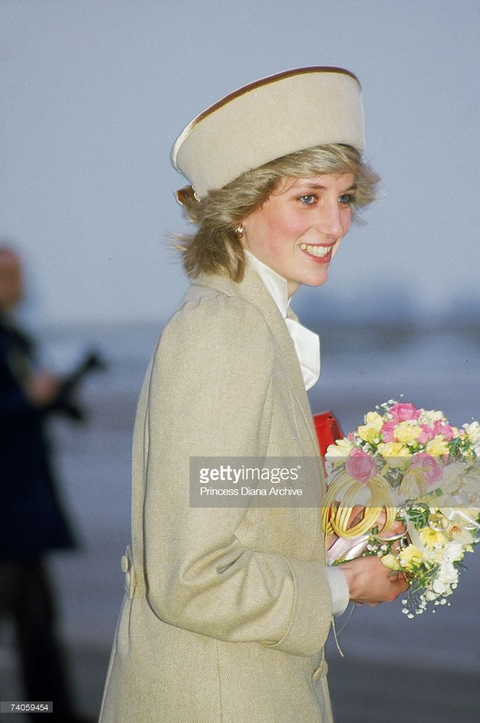 The Princess of Wales arrives at East Midlands airport for a visit to Derby, wearing a coat designed by Caroline Charles, 19th February 1985. (Photo by Jayne Fincher/Princess Diana Archive/Getty Images)