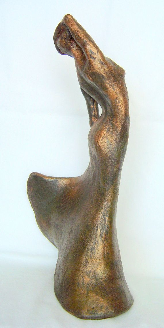 The sculpture was done from my imagination and was sculpted in clay.. It depicts a female figure dancing and twirling. She is feeling quite free and is in her own world of music and dance. She was fired to cone 10 and a patina was applied to give the effect of bronze. The piece measures 12 by 8 inches and is an original piece of art made by me. For shipping information out of the United States, please inquire and I will let you know the cost.