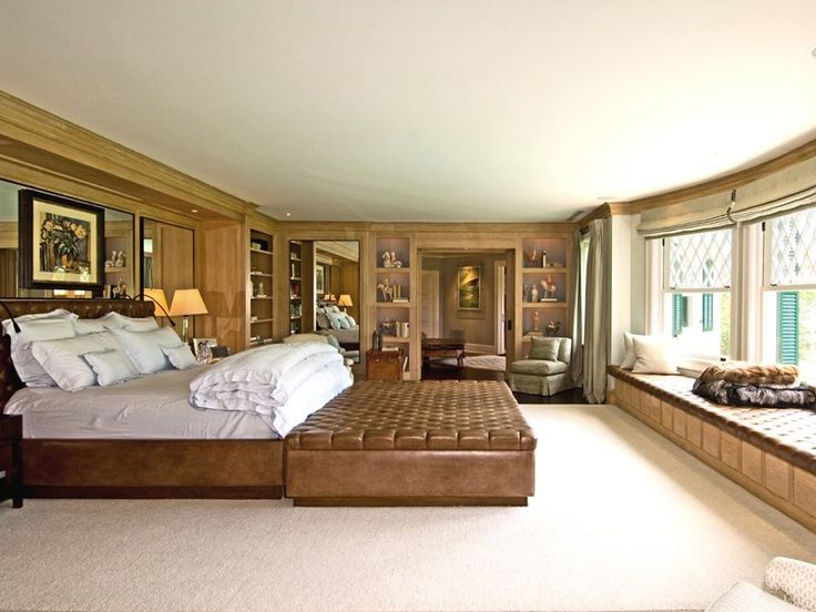 the master suite has a large bay window with a sweeping view of the verdant property