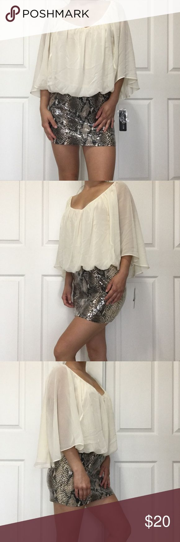 Going out dress Fun and flirty going out dress from Rampage! Chiffon type material up top, fun flowy sleeves with a sequined patterned skirt. Has great stretch to it for comfort. Pretty sheer, should wear nude under! NO TRADES Dresses Mini