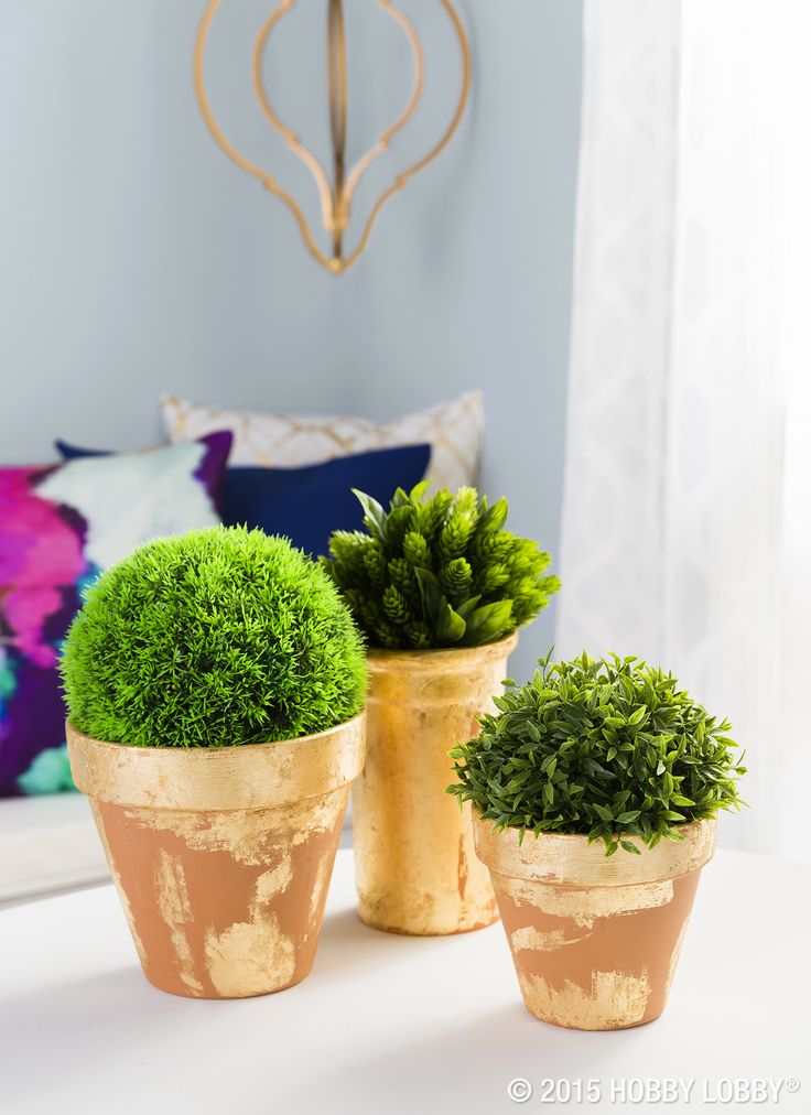A mini container garden gets a modern facelift with laid-back strokes of gold leaf. The key here is to stick with minimal amounts of adhesive—the less you use, the splotchier the sections of leafing will be. TIP: If your pot will be outdoors, protect your design with a thin coat of liquid sealant.