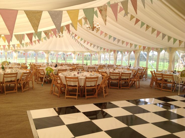 Pretty #bunting and #blackandwhite #dancefloor in this stunning #spring #wedding #marquee...