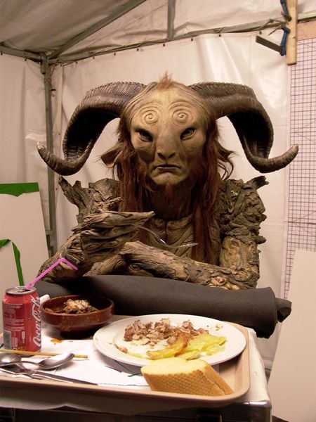 "Behind the scenes of ""Pan's Labyrinth"". Doug Jones (Fauno / Pale Man) eating breakfast in costume."