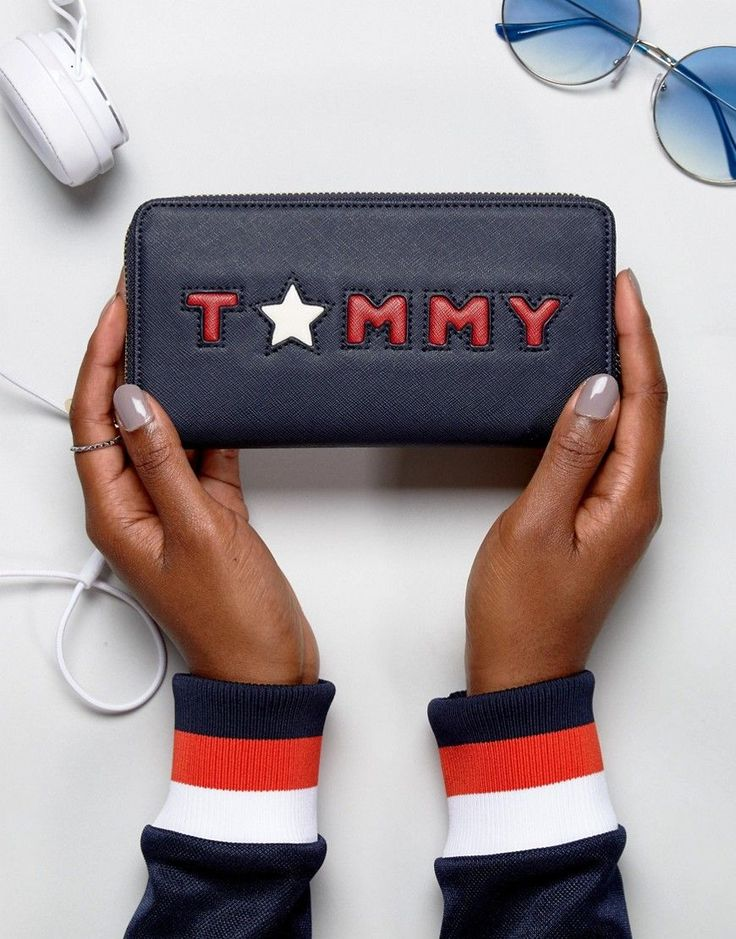 Get this Tommy Hilfiger's purse now! Click for more details. Worldwide shipping. Tommy Hilfiger Star Logo Zip Around Purse - Black: Purse by Tommy Hilfiger, Faux leather outer, Zip closure, Zipped inner pocket, Multi card and cash compartments, Tommy branding to front, Wipe clean, 70% Polyurethane, 30% Polyvinylchloride. Tommy Hilfiger is a global brand with a classic/cool American heritage. Think timeless, preppy Americana, updated, re-imagined and always changing across a collection of…