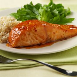 Sweet Orange Glazed Salmon... Prepared in a skillet in 25 minutes this salmon recipe features a sauce of sweet and sour sauce with orange marmalade