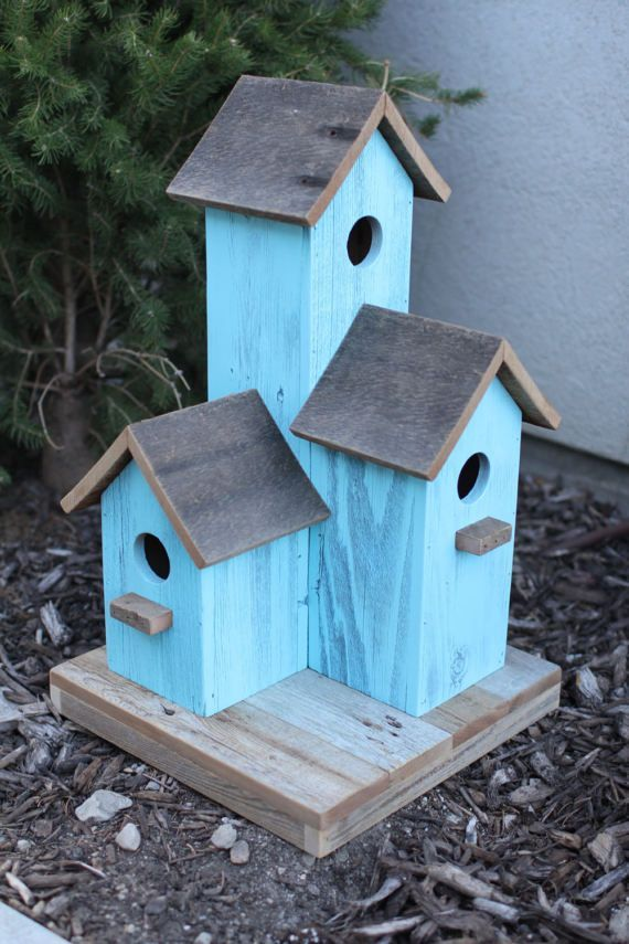 These one of a kind birdhouses are made from 100% reclaimed barnwood. Our birdhouses are the perfect addition to any yard or garden. The birdhouse comes in three different color options: Natural Barnwood, Blue-Aqua, or White. This is a larger bird house: 21.5 inches tall and the base #birdhouseideas