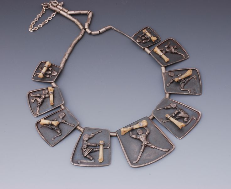 """Extraordinary necklace by Ruth Roach in sterling with bird bones and wire in scenes of children playing outdoor games; largest sterling plaque is about  1-1/2"""" x 1-1/8""""; whole necklace is about 22"""" around; marked: """"ROACH, STERLING; """" fine condition.  This necklace is pictured in Ruth Roach, Uncommon Jeweler, MODERN SILVER magazine, Aug/Sept, 2002."""