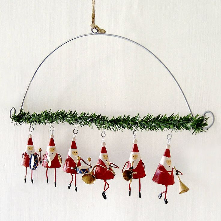 father christmas band hanging garland by red lilly   notonthehighstreet.com