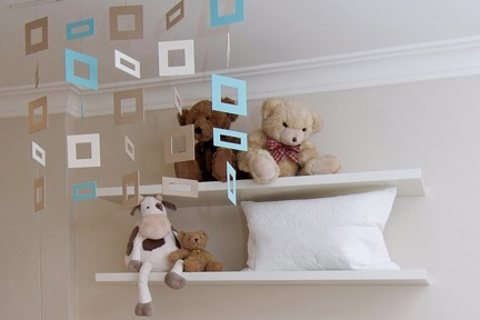 The contemporary custom made mobile adds just a hint of colour in this neutral colour scheme nursery. http://www.kidsindesignedspaces.com.au/residential/babyproject1