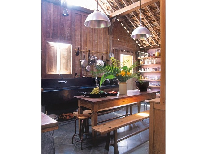 Balinese house kitchen, with a mix of old (joglo walls) and new (waxed concrete sink). Photo Jacob Termansen.