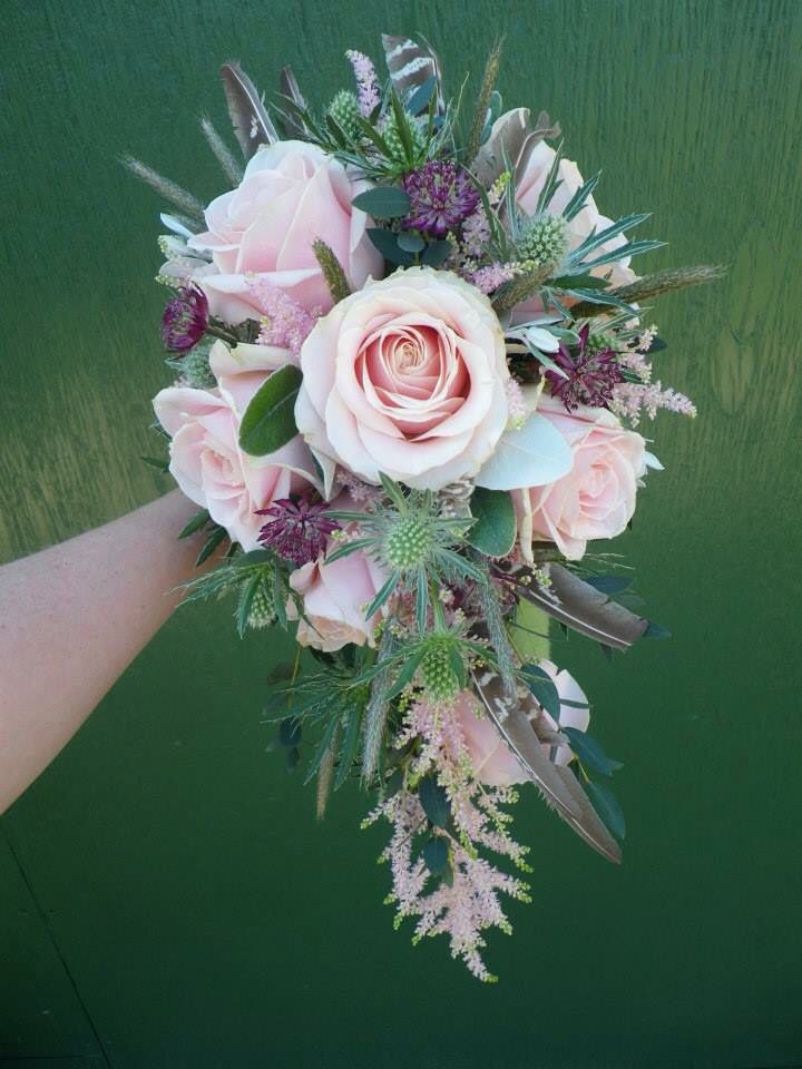 Country, woodland, shower bouquet with feathers. Flowers by Davina