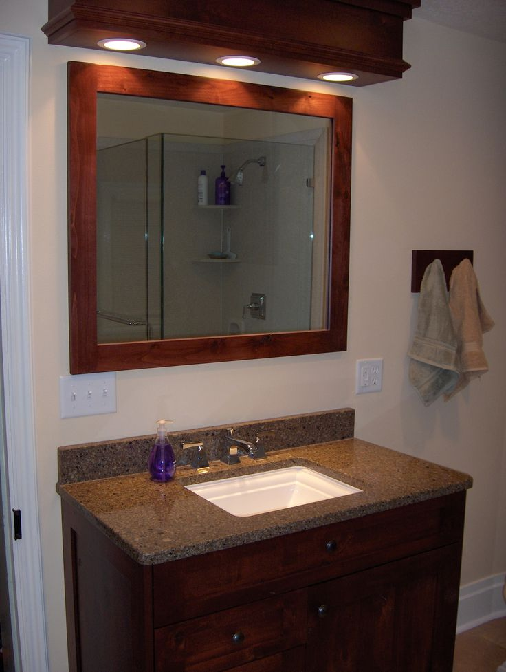 Bathroom Remodel Framed Standalone Mirror Single Faucet Sink Dark Wood Cabinets Stone