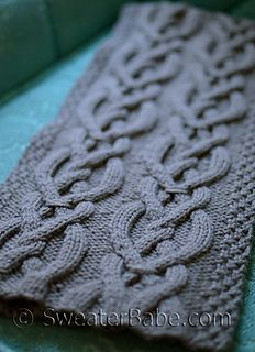 A classic wool scarf made even better with two columns of eye-catching cable work.