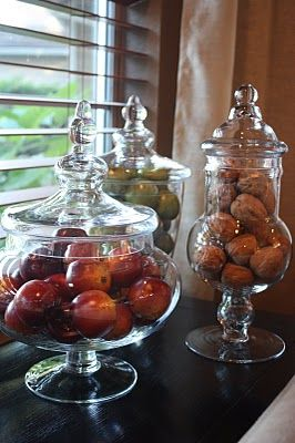Apothecary jars full of fall fruit and nuts - a pretty way to add seasonal color and dimension