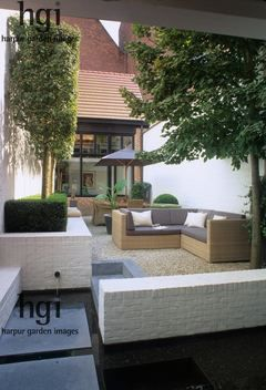 Harpur Garden Images :: swin2 Small courtyard garden, white painted walls. L-shaped rattan sofa. Table and chairs with umbrella creating shade. Topiarised trees in raised bed edged with low Buxus hedging. modern water outdoor living lifestyle entertaining room entertainment box parasol relaxation Christoph Swinnen s own garden, Sint Niklaas, Contemporary City Small gardens Walls Seating Dining Small water features Raised beds/ terraced Topiary Gravel Hedges Belgium. Jerry Harpur