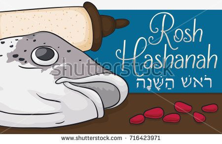 Banner with traditional fish head, pomegranate seeds and scroll to celebrate Jewish New Year or Rosh Hashanah (written in Hebrew).