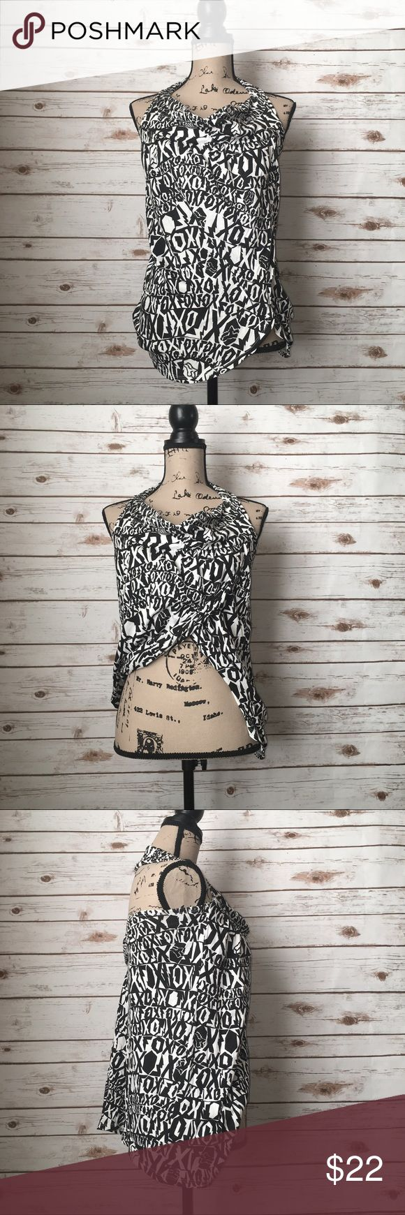 "Fox Racing Logo Halter Black/White Top Size S Size S   Armpit to armpit: 12""   Length: 23""  Fabric: 55% Cotton 45% Modal   Fox Racing logo print   Black/white   Wrap around Blouse/top/shirt  Halter/Neck   Open upper back Fox Tops"