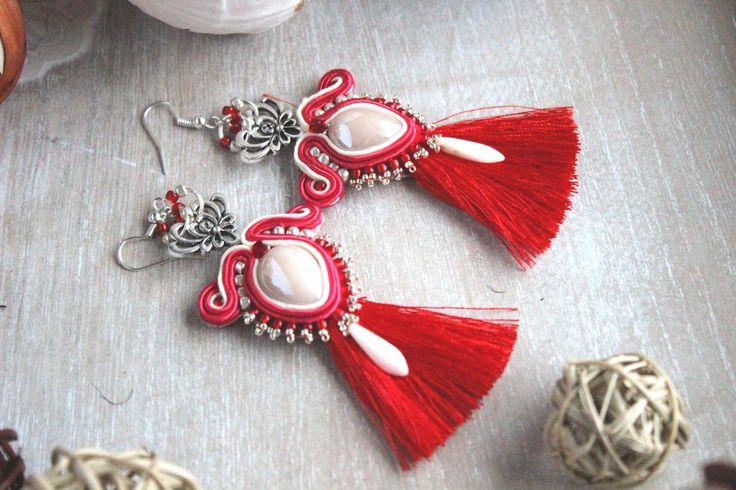 Red and beige soutache, oval beige cabochon in shape of teardrop, toho and dagger beads, red tassel, silver oriental elements