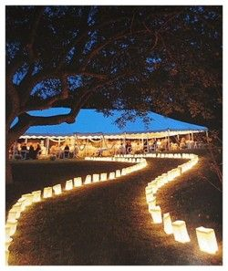 Candlelit path to the reception. I will most def be doing this if I have an outside wedding.