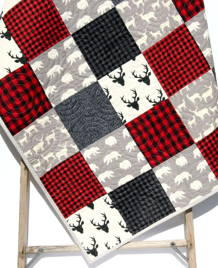 "Buffalo Plaid Quilt Modern Baby Bedding Woodland Deer Buck Bear Nursery Bedding Red Black Gray Lumberjack Plaid Check Handmade Crib or Toddler Size. This modern boy quilt features a fun woodland theme with buffalo plaid, bears, bucks, and deer. The colors are nice and modern ivory, gray, and red. You can choose the size baby (34""x41"") or toddler (34""x54""). A quilt is three layers stitched together, with the middle layer being a natural cotton batting. Professionally quilted on a long arm..."