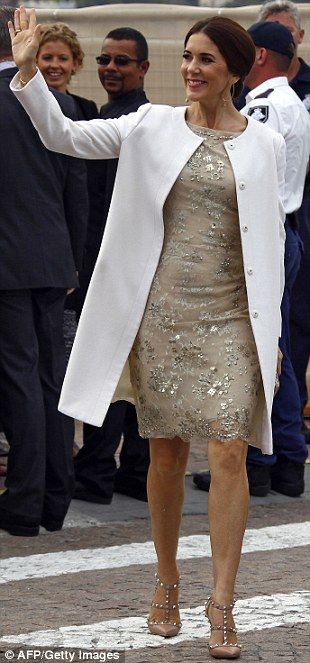 Denmark's Crown Princess Mary waves to members of the public as she arrives at the Sydney Opera House in October 27, 2013