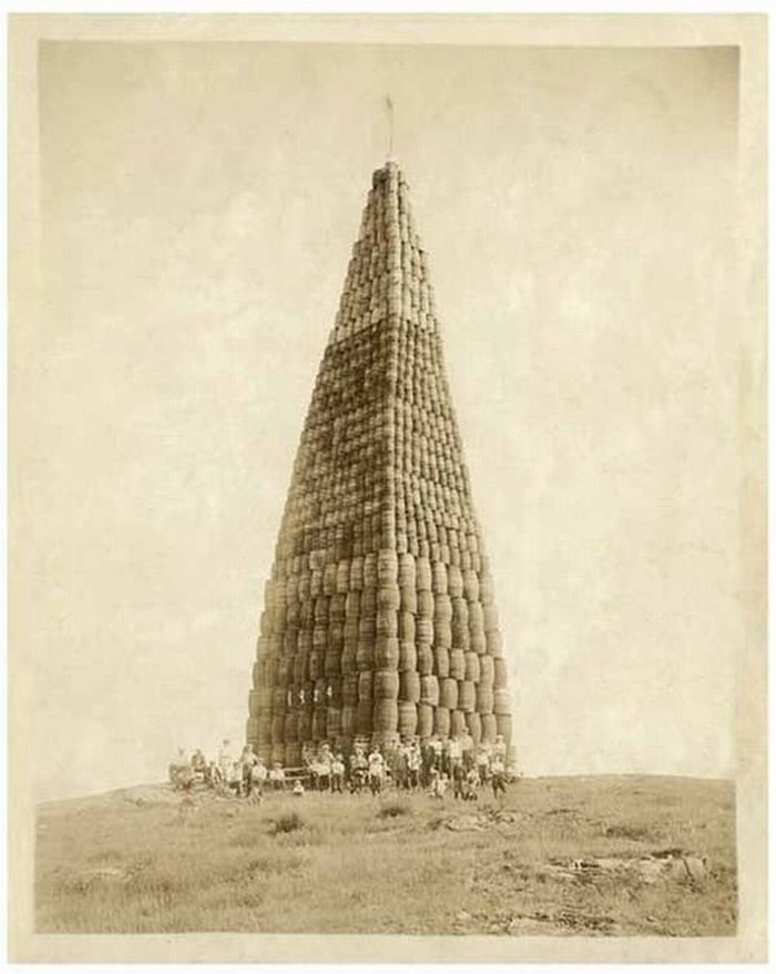 Tower of barrels of alcohol to be burned, 1924