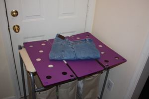 How to Fold Pants With the FlipFold Shirt and Laundry Folder: Folding Pants With the FlipFold Laundry Folder - Step 6