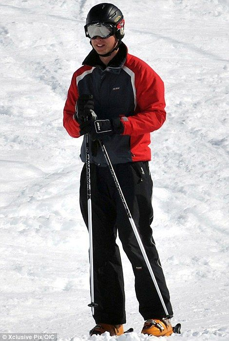 Safety first: The Duke of Cambridge took no risks and sensibly wore a helmet as he braved the powder earlier today