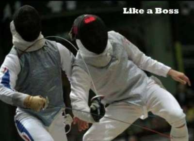 From a fencing standpoint, this is just badass beyond belief    [ID: a foil fencer getting a touch backwards over his shoulder. Text: Like a Boss.]