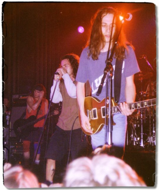 """Pearl Jam March 4th 1992, Tivoli, Utrecht Eddie being in Utrecht got a tattoo on his calf. The tattoo it's a crossed tomahawk and a wrench on his right calf, is the logo of Earth First. On March 4th, one of the greatest shows at least for Eddie. The Tivoli Gardens was packed with 950 people, and at the end Eddie mentioned what he did the day before """"I wasn't going to say anything about this, but then I thought I should, because this is the first show I've ever played with a tattoo. I'm now a…"""