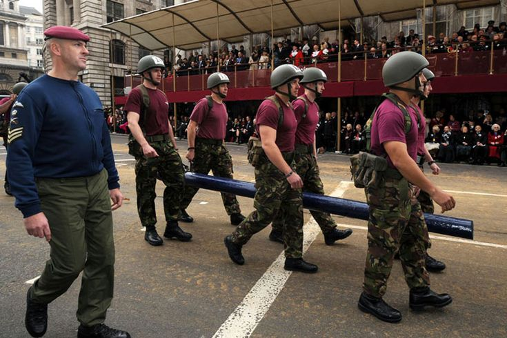 Paratroopers demonstrate a log run at the Lord Mayor's Show