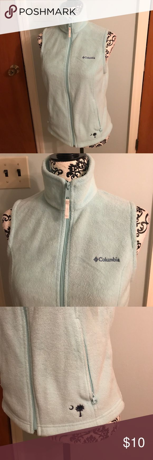 Women's Columbia Vest Women's Columbia Fleece Vest. In great used condition. No stains or signs of wear. Palmetto Tree & Moon Under left front pocket. Fabric pockets on inside. Columbia Jackets & Coats Vests