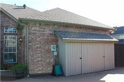 Long narrow shed built into side of house.