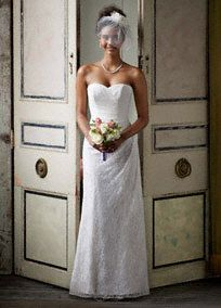 Timeless and elegant, this lace over satin gown is sure to wow as you walk down the aisle.  Sweetheart bodice is feminine and chic.  Side-drape drape�and subtle ruching create a slim�and stunning silhoutte.  Lace over satin fabric adds contrast and texture.  Sweep train. Available in�Ivory and White.  Fully lined. Back zip. Imported. Dry clean only.  Also available in Plus sizes,14W-26W, Style 9WG3263,  (special order only).  To preserve your wedding dreams, try our Wedding Gown Preservation ...
