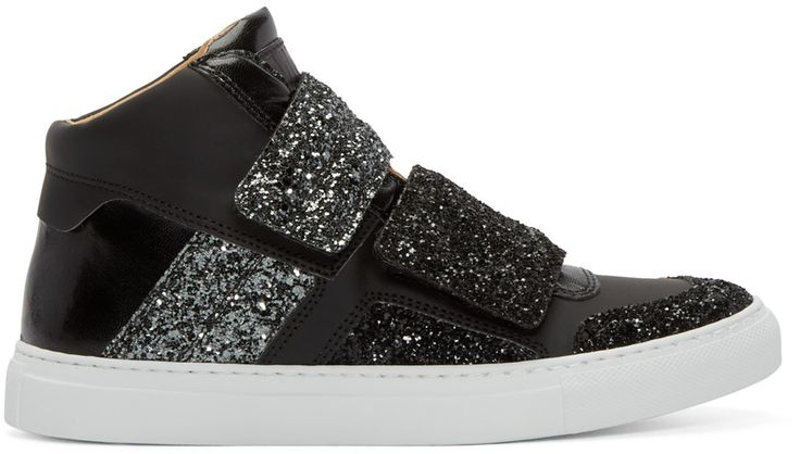 High-top leather sneakers in black. Panelling at toe, vamp, and sides in black and grey glitter. Round toe. Velcro closure at vamp. Padded tongue with logo patch. Padded collar. Textured white rubber sole. Leather lining in tan. Tonal stitching.