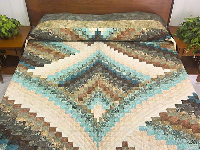 Lightning Strikes Bargello Quilt. A striking Bargello design with gorgeous Batik style cotton prints selected by C Jean Horst. Note the care taken with the complicated piecing, and the fantastic border fabrics.
