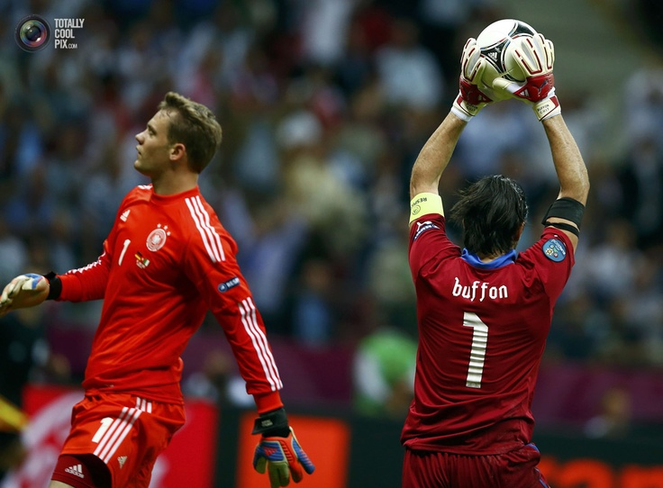 Italy's Buffon makes a save next to Germany's Neuer during their Euro 2012 semi-final soccer match at the National stadium in Warsaw. KAI PFAFFENBACH/REUTERS