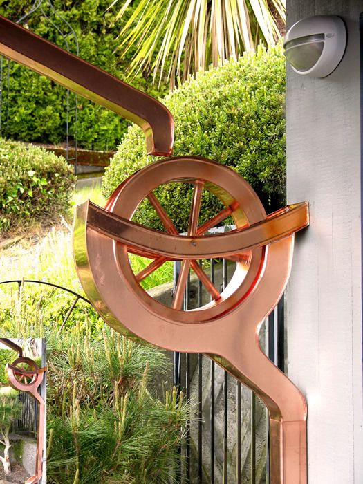 Copper water wheel copper downspout. Brings an aesthetically pleasing look to your outdoors.