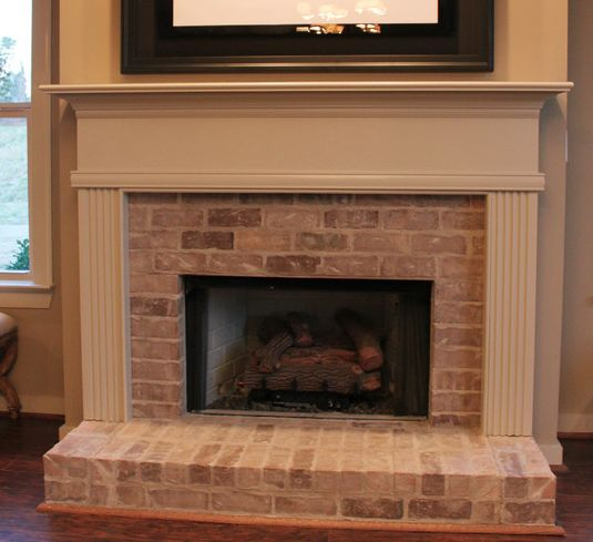 Whitewash brick fireplace mezes formal living spaces Color ideas for living room with brick fireplace