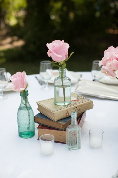 #books #posies #centerpieces Photography by karamillerphotography.com  Read more - http://www.stylemepretty.com/2013/01/18/douglas-flat-wedding-from-kara-miller-photography/
